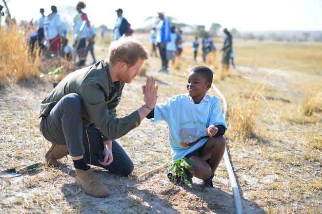 Prince Harry high five African schoolboy