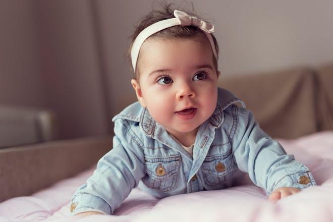Baby girl in denim jacket