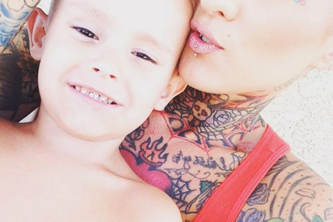 tattooed mum with son