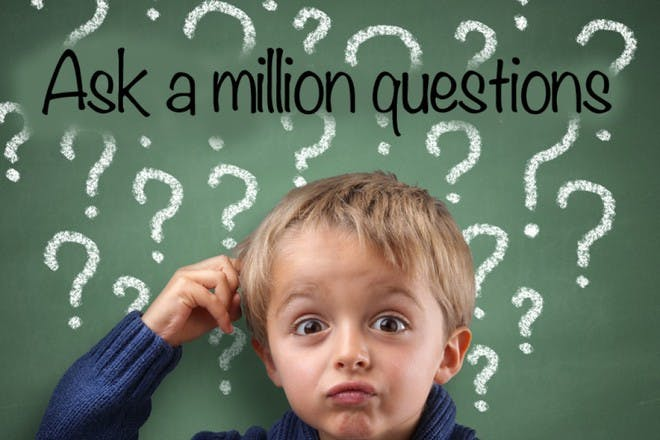little boy with lots of question marks