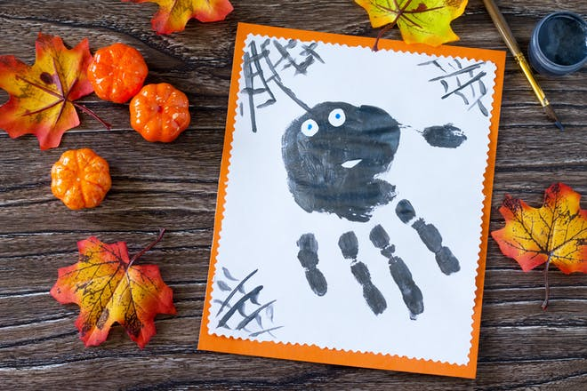 Black spider handprint craft for Halloween