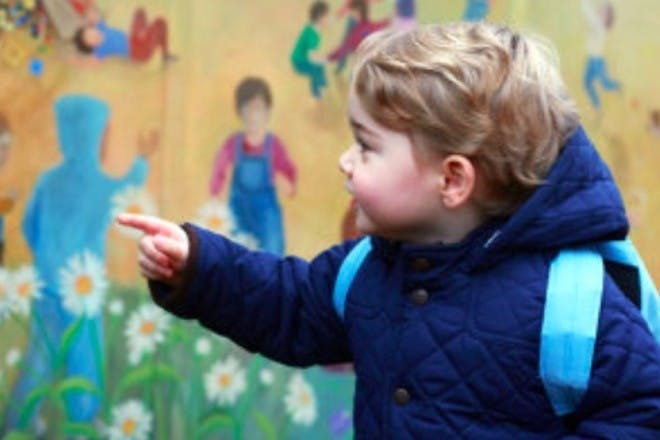 prince george with school bag on back