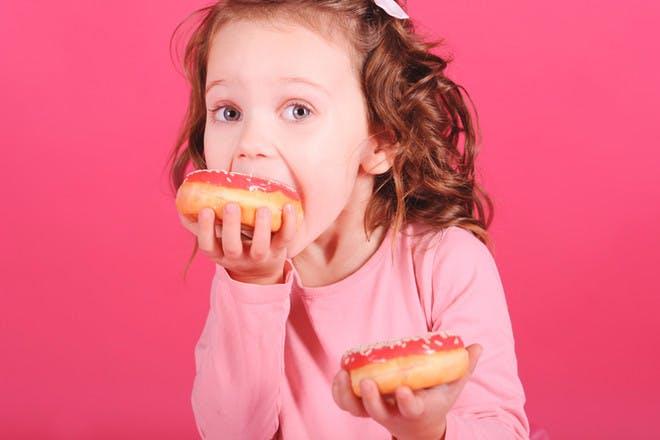 Girl eating doughnuts