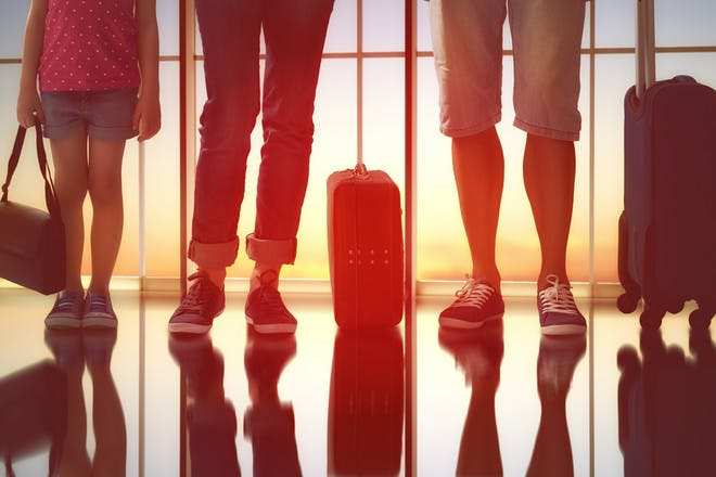 Feet and suitcases in airport