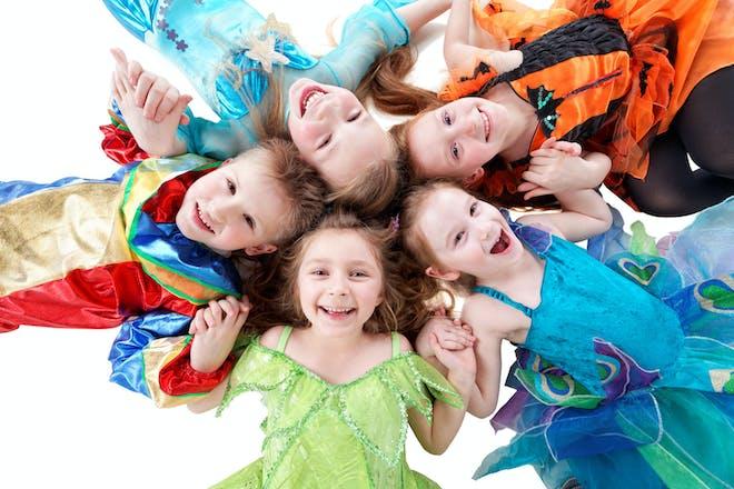 A group of smiling kids in fancy dress
