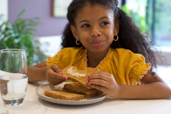 Girl having after school snack