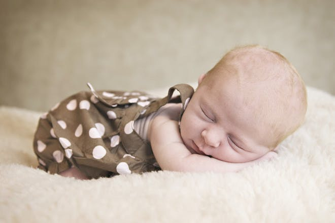 Baby in spotty outfit