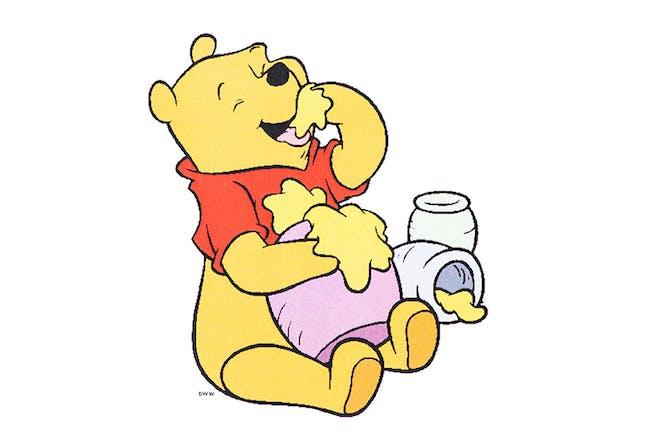 Cartoon of Winnie the Pooh eating honey