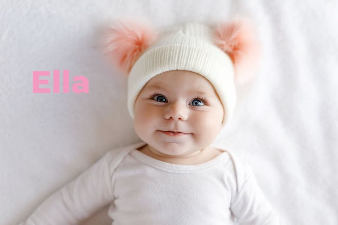 Baby wearing hat with fluffy pink ears. Name Ella written in text