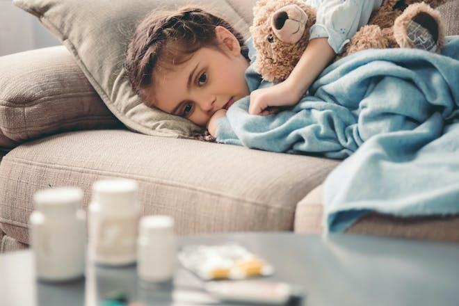 sick child on sofa