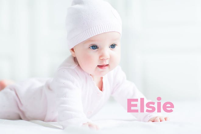 Baby trying to crawl wearing hat. Name Elsie written in text