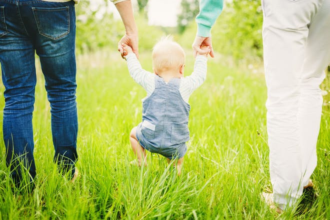 Parents and baby walking