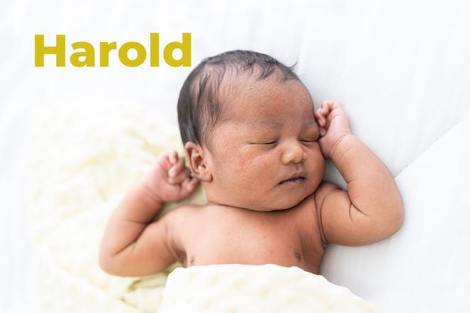 Sleeping baby with yellow blanket. Name Harold written in text