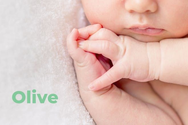 Close up of baby's mouth and hands. Name Olive written in text