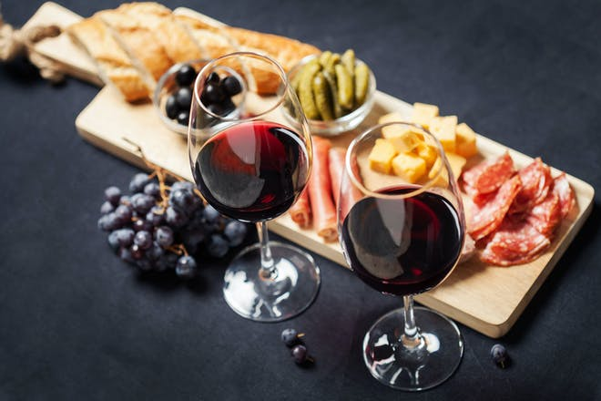Wine and cheeseboard with nibbles