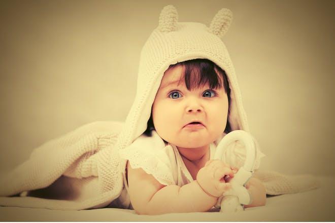 baby girl in hooded towel
