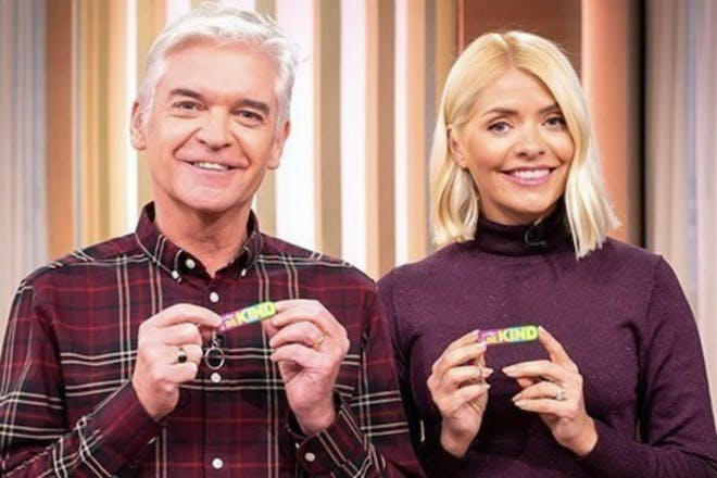 Holly and Phil pose with BEKIND keyrings