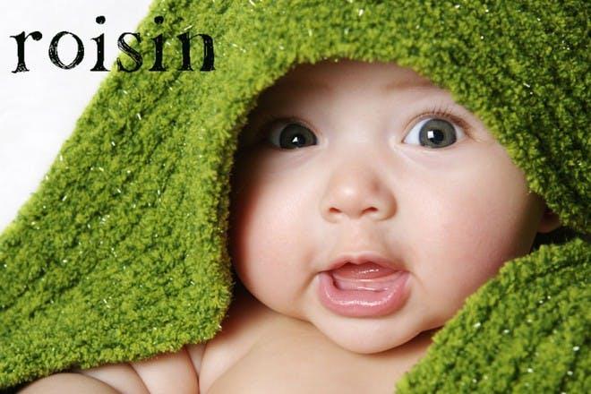 baby under green towel