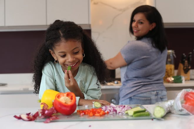 Kid cooking in kitchen with mum