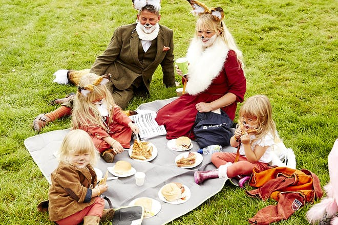 family having picnic dressed as foxes at Just So Festival