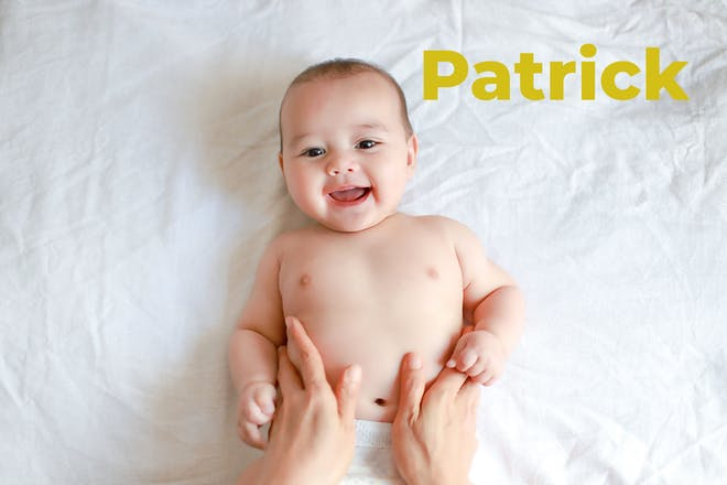 Baby smiling, mum's hands on tummy. Name Patrick written in text