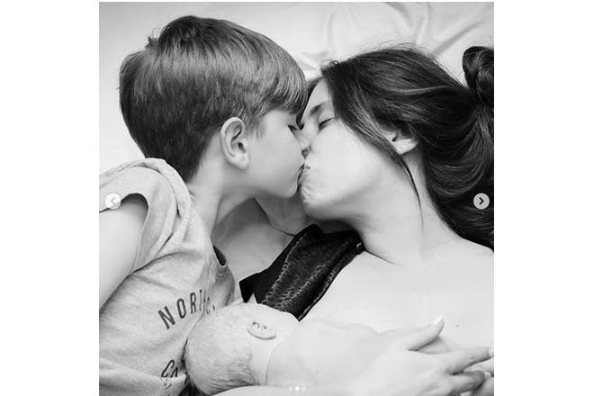 Stacey Solomon kissing her son after the birth of her new son