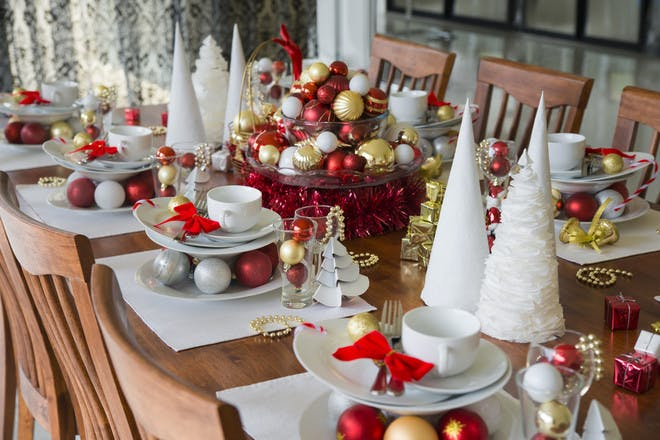 Paper cones and baubles around Christmas table