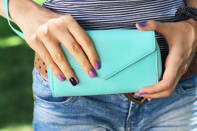 Woman's hands holding purse