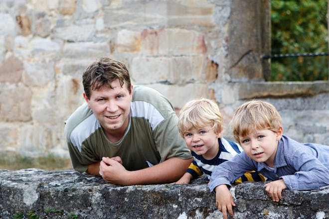 Dad with two sons at a castle