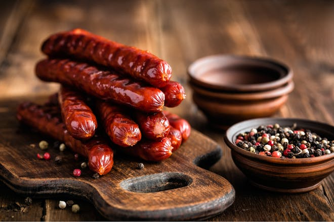 sausages on bread board