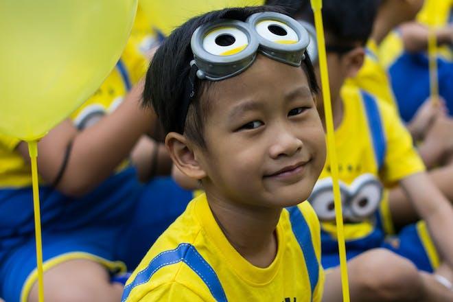 A boy dressed as a minion