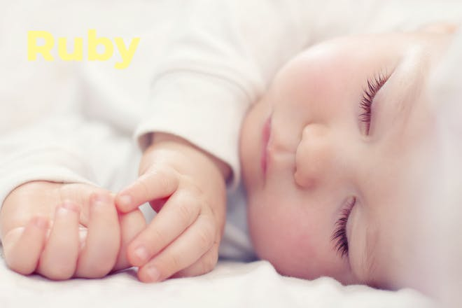 Sleeping baby. Name Ruby written in text