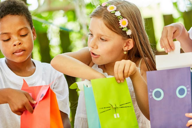 children looking in party bags