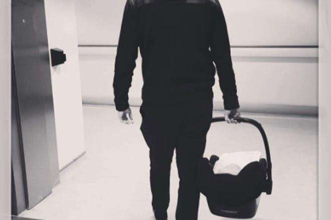 Greg Shepherd with newborn son
