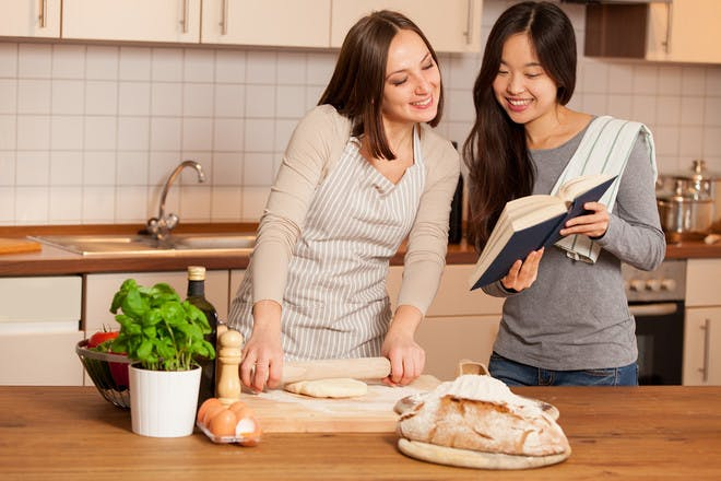 Two women cooking in kitchen