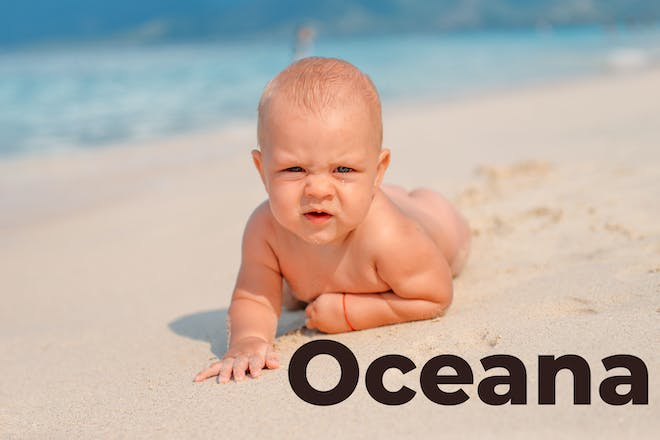 Baby on the beach with Oceana written in text
