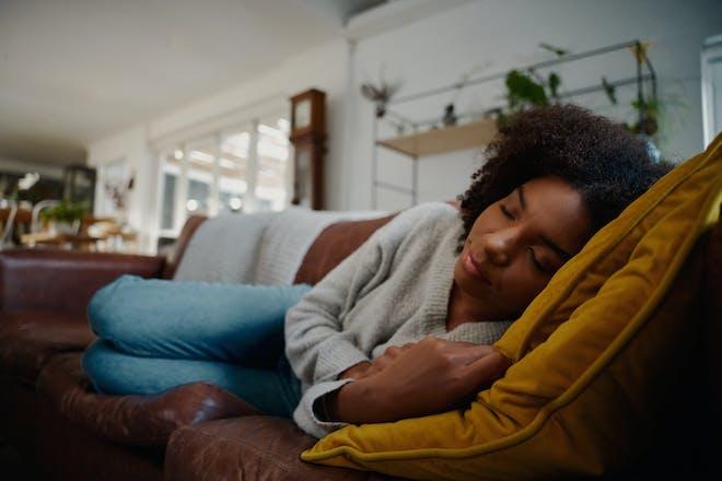 Woman napping on sofa
