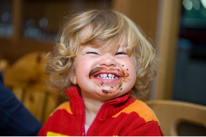 toddler with food all over face