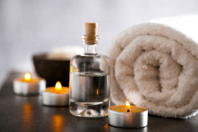 Spa towel oil and candles