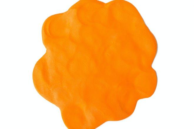 Orange play dough against white background
