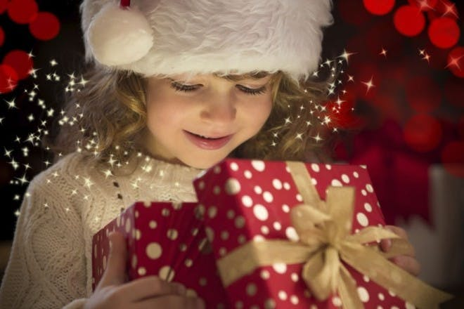 Child opening a gift