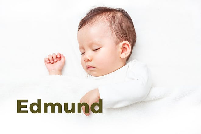 Sleeping baby with white blanket. Name Edmund written in text