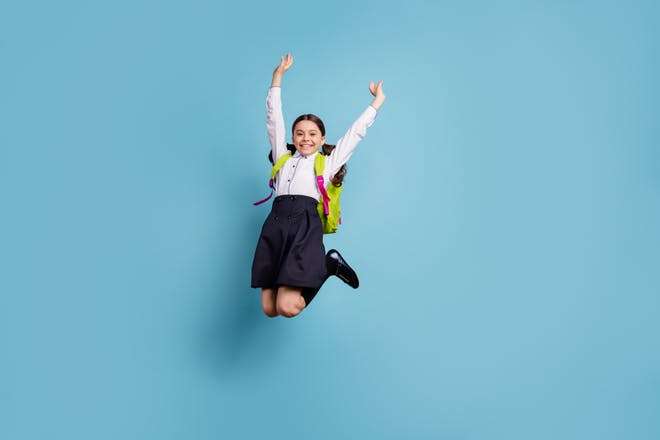 school girl jumping in the air