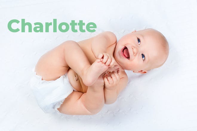 Baby lying on back holding feet. Name Charlotte written in text