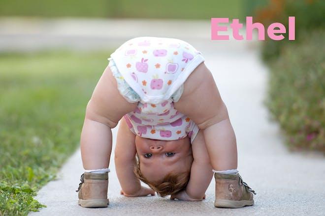 Toddler bending over and looking between legs. Name Ethel written in text