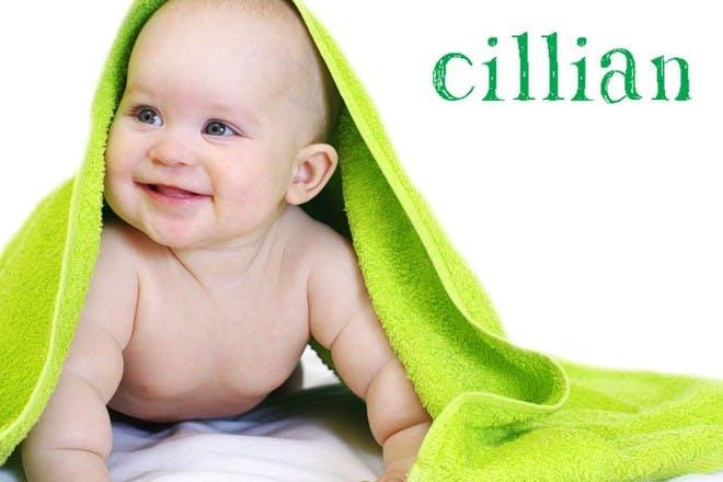 child under green towel