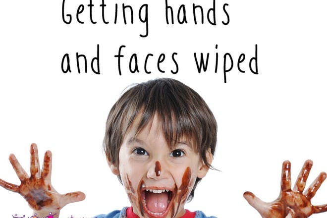 child with mess on face and hands
