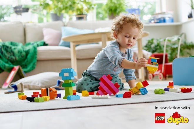 child playing with duplo