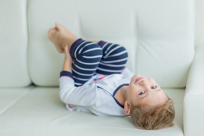 Boy in pyjamas on sofa