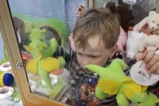Toddler stuck in claw machine